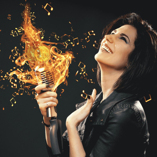 Woman Speaking Into Fiery Microphone In Mobile Size