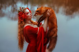Woman in red with a red fox